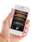 Siri en IPhone 4s Foto de archivo libre de regalías