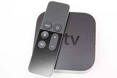 Siri remote over New Apple TV console Stock Photography