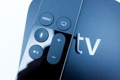 Siri remote over New Apple TV console Stock Images