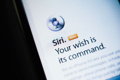 Siri voice command on Apple smartphone and tablet. CUPERTINO, UNITED STATES - FEBRUARY 11, 2012: Siri the intelligent personal assistant and knowledge navigator Royalty Free Stock Photo