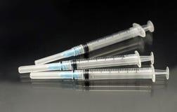 Siringa medica di vaccinazione tre Fotografia Stock