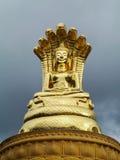 Sirisattarat Buddha, a posture of bhudda statue made of bronze. Closeup shot of Sirisattarat Buddha, a posture of bhudda statue covered with seven nagas or Royalty Free Stock Images