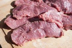 Sirloin beef on a cutting board. Lilac sirloin beef on a wooden cutting board Royalty Free Stock Photography