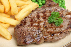 Sirloin Beef Steak Dinner with Chips Stock Images