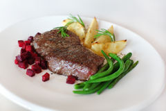 Sirloin with beetroot, beans and potatoes Stock Images