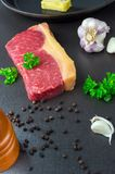 Sirloin With Coat. Beef sirloin steak. Fresh with garlic, black pepper and parsley royalty free stock image
