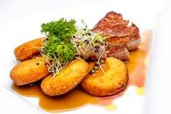Sirloin with crispy potato and green pepper sauce Stock Photos