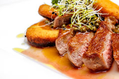 Sirloin with crispy potato and green pepper sauce Royalty Free Stock Photo