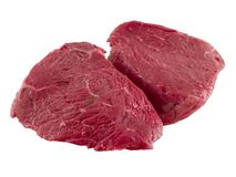 Sirloin Steak. A close up on two blood red Sirlion Steaks Stock Image