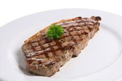 Sirloin Steak. Freshly griddled sirloin steak on a white ceramic plate Stock Image