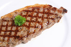 Sirloin Steak. Close-up of juicy sirloin steak garnished with a sprig of parsley Royalty Free Stock Image