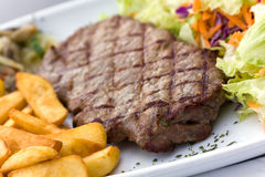 Sirloin steak with chips ,mushrooms,salad Stock Photo