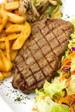 Sirloin steak with chips ,mushrooms,salad Stock Image
