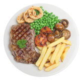 Sirloin Steak Dinner. Sirloin steak with chip, peas, mushrooms and onion rings Royalty Free Stock Photos