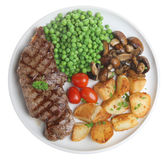 Sirloin Steak Dinner. Sirloin steak with sauteed potatoes, mushrooms and peas Stock Photo