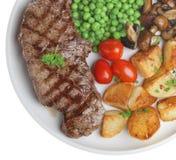 Sirloin Steak Dinner. Sirloin steak with sauteed potatoes, peas and mushrooms Stock Images
