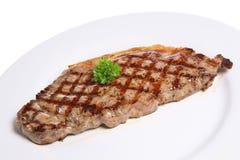 Sirloin Steak Dinner Plate. Freshly griddled sirloin steak on white plate Royalty Free Stock Photography