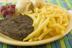 Sirloin steak and fries Stock Images