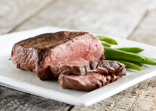 Sirloin steak with green beans. Closeup photo of a sirloin steak with green beans shot with selective focus royalty free stock image
