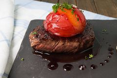 Sirloin Steak with plum Stock Images