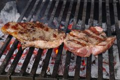 Sirloin steak prepared on the barbecue grill. Royalty Free Stock Images