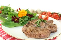 Sirloin steak. A roasted ribeye steak with wild herb salad stock image