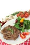 Sirloin steak. A roasted ribeye steak with wild herb salad royalty free stock image