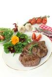 Sirloin steak. A roasted ribeye steak with wild herb salad stock photos
