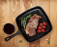 Sirloin steak with rosemary and cherry tomatoes on frying pan Royalty Free Stock Image