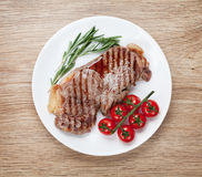 Sirloin steak with rosemary and cherry tomatoes on a plate Stock Images