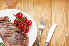 Sirloin steak with rosemary and tomatoes Stock Image