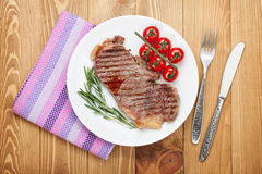 Sirloin steak with rosemary and tomatoes Royalty Free Stock Photo