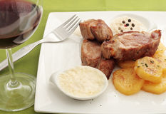 Sirloin steak in two sauces Stock Photo