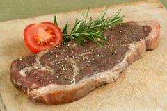 Sirloin steak uncooked on wooden board Royalty Free Stock Photo