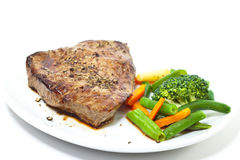 Sirloin steak with vegetables Stock Photos