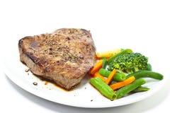 Sirloin steak with vegetables Stock Photos