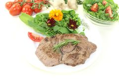 Sirloin steak with wild herb salad Royalty Free Stock Photo