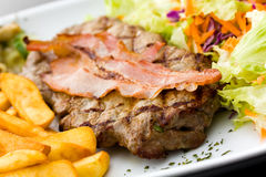 Sirloin Steak With Chips And Bacon Stock Image