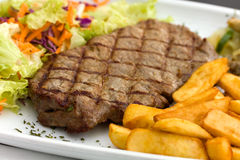 Sirloin Steak With Chips ,mushrooms,salad Stock Photography