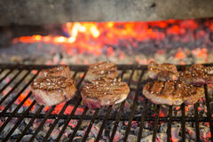 Sirloin steaks on grill Royalty Free Stock Images