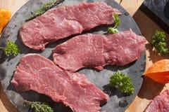 Sirloin on a stoneplate. Three sirloin chunks on a stoneplate, in kitchen Stock Photo