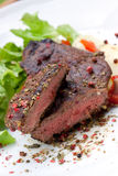 Sirloin strip steak with boiled potato Stock Photos