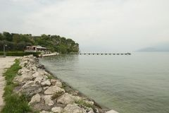 Sirmione and sea beach, Italy royalty free stock photography