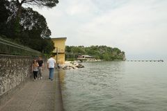Sirmione city and lake beach, Italy royalty free stock images
