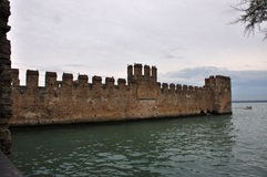 Sirmione fortress alongside lago di Garda Royalty Free Stock Images