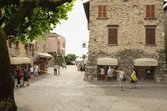 Square near medieval castle in Sirmione city, italy royalty free stock photo