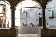 Sirmione, Italy. Arcade entrance of the Chiesa di Santa Maria Maggiore or Della Neve, parish church of the small town and peninsula of Sirmione, province of Royalty Free Stock Photo