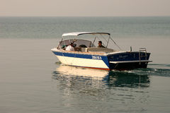 SIRMIONE, LAKE GARDA/ITALY - OCTOBER 27 : A motorboat slowing cr. Uising on Lake Garda Italy on October 27, 2006. Unidentified people Stock Image