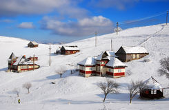 Sirnea village in winter, Romania. Winter landscape in Sirnea village (this is the first touristic village from Romania) with isolated houses stock image