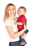 Sirva de madre a detener a un bebé en sus brazos Fotos de archivo